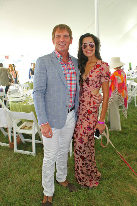 Polo player and model Rebekah Pizana wearing For Love & Lemons and Stuart Weitzman, with David Greenhill, polo player and owner of Greenhill Winery & Vineyards, wearing Ralph Lauren and Sand Copenhagen.