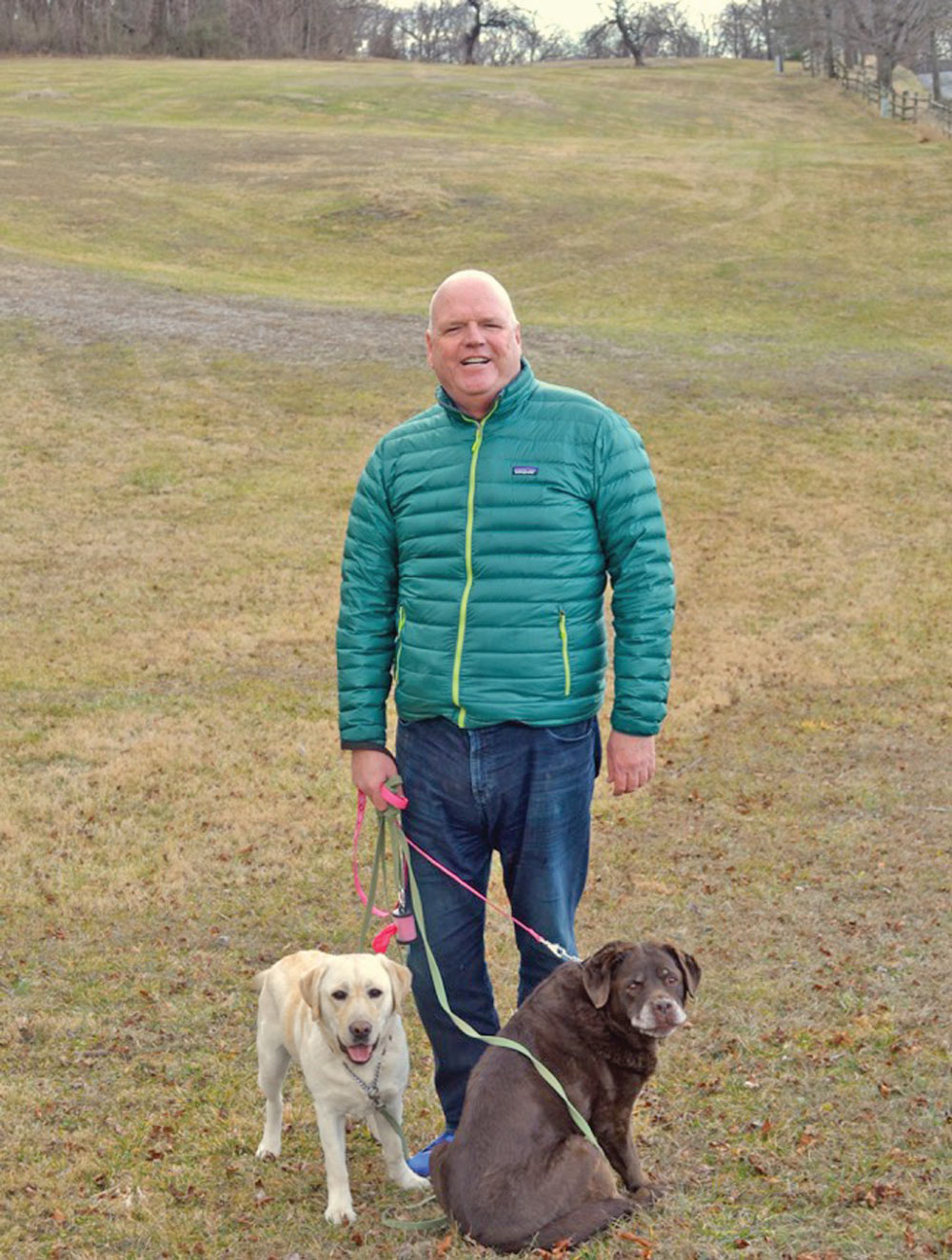 Bill Cauzens with his dogs near his home  outside Middleburg.