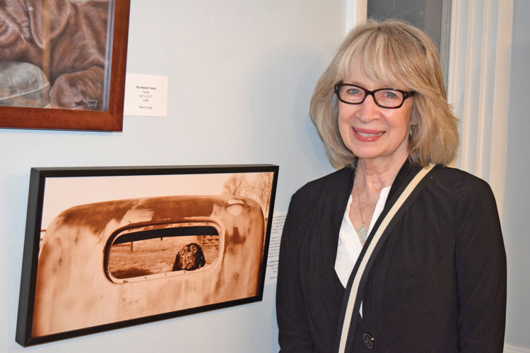 Artist Kathy Kupka with her piece, titled I called shotgun.