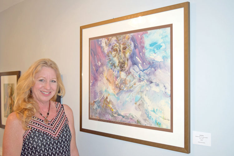 Deborah Elaine with her colorful and powerful piece, titled Cold Run.