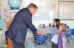 Governor Ridge is greeted by students in a Middleburg Community Charter School classroom.