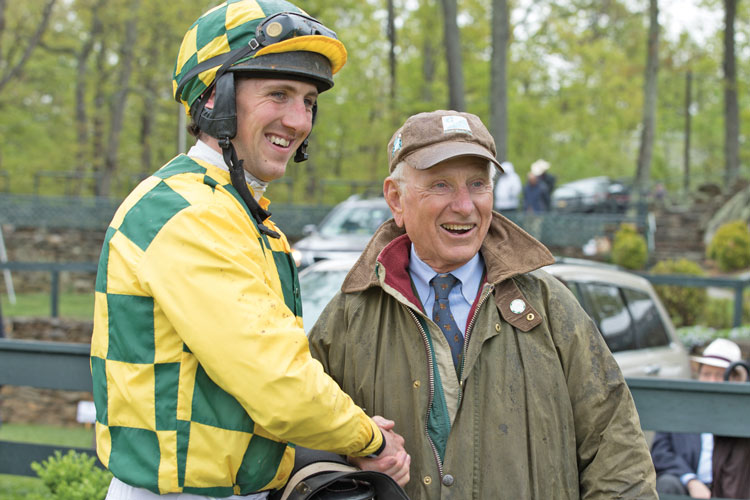 Owner Robert A. Kinsley congratulates jockey- Jack Doyle after his win in the Middleburg Bank Plate training flat race.