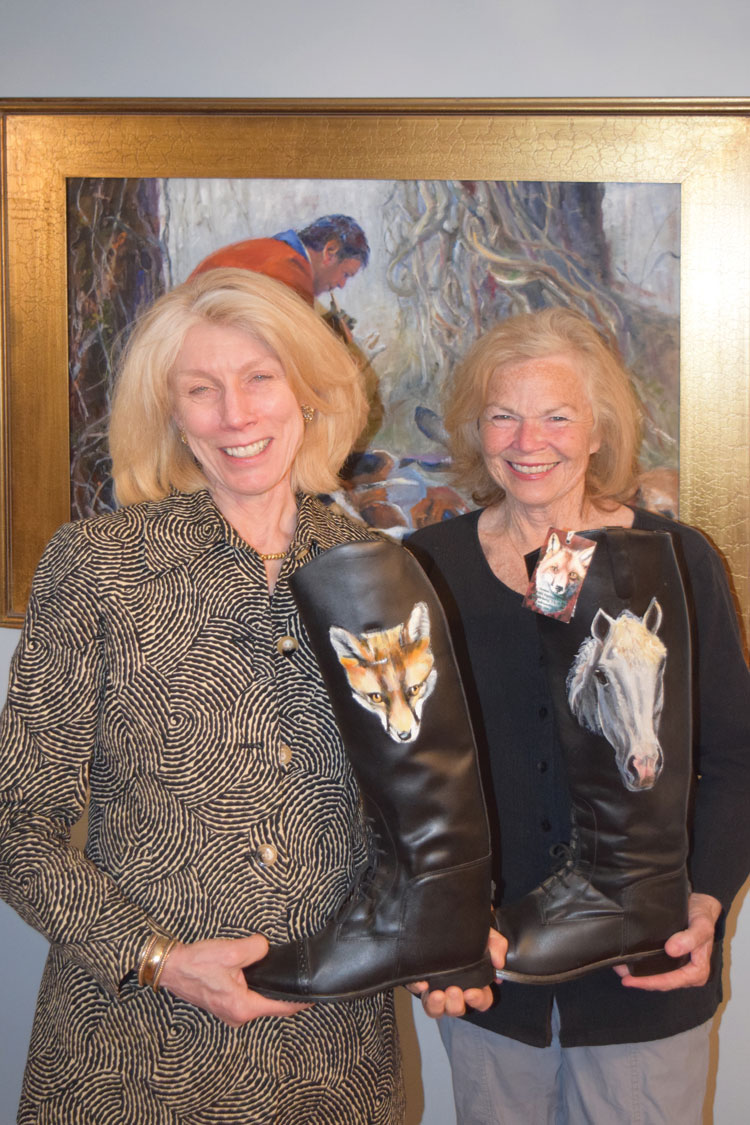 Sandy Danielson with Carole Stadfield holding the work of a dear friend and local artist, Debbie Cadenas.