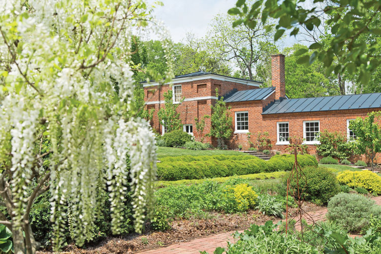 The brick building in the garden is called the garden dependency. It is believed to have been used by slaves as a kitchen and laundry.