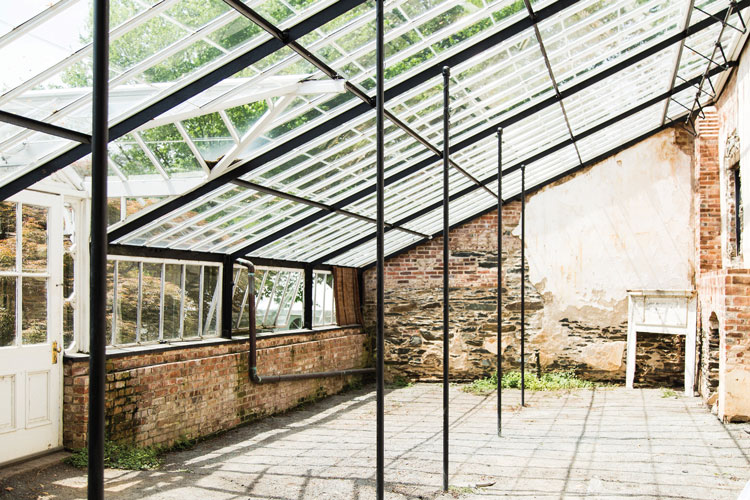The greenhouse was built by slaves in 1810 from brick and iron, and shows the Carters' interest in modern horticultural practices.