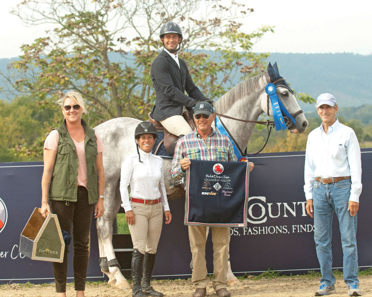 Augustin Rosales winner and Grand Champion of NAYDJP riding Starfighter, owned by Gail Dady and sponsored by Denise DeRisio Perry.