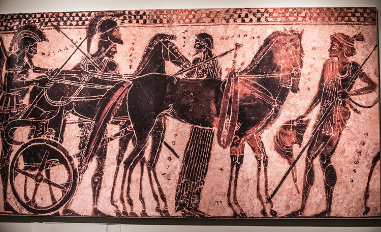Attributed to the Sappho Painter, Greek (Attic), Black Figure White Ground Lekythos, ca. 510 BCE, Quadriga chariot horses being harnessed, terracotta, 8.75-x-2.375, Private Collection, Virginia. Photo by Eryn Gable of Focal Point Creative