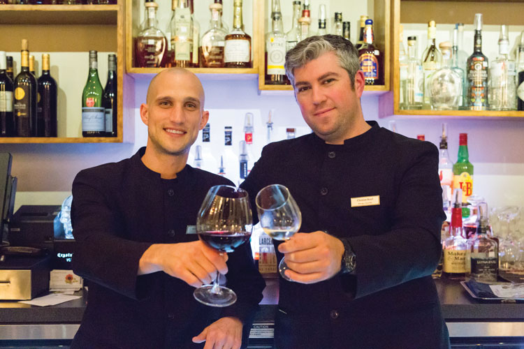 Sommelier Christian Borel and server Miles Patterson close out the evening at Le Bar.