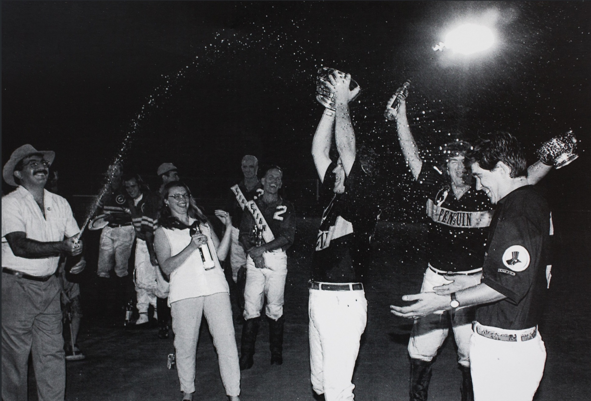 "Penguin Vodka founder (left) celebrates his team victory with players (from left to right) Peter Arundel, Rick Barrow and Juan Salinas. ""Big Joe"" Muldoon is visible in the background. Photo courtesy of Peter Arundel."