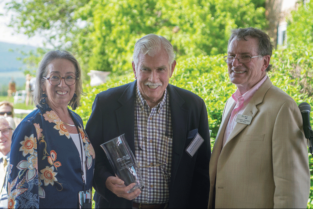 Sally Price, LTV Executive Director, Malcolm Matheson accepting Conservationist of the Year for Leadership and Lifetime Achievement on behalf of Jacqueline Mars, and LTVs Board Chair, Chris Dematatis