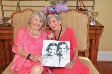 Ann MacLeod and her late sister, Kit, were so close in age that people thought they were twins. To commemorate dressing alike growing up, the pair wore similar outfits for the 95th Birthday Bash that Beth Ann Mascatello threw for Ann in 2017. Kit passed away later that year. Photo by Nancy Milburn Kleck Photography.